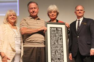"""<p>Calvin and Marilyn LeHew with their """"Thank you for all you've done for local historic preservation"""" award flanked by Mary Pearce, Heritage Foundation excutive director and Julian Bibb, Heritage Foundation executive board president.</p>"""