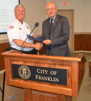 <p>Franklin Mayor Ken Moore presents Franklin Fire ChiefRocky Garzarek with a proclamation declaring October 4-10 as Fire Prevention Week at a recent BOMA meeting.</p>
