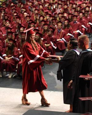 <p>Franklin High School Principal Willie Dickerson awards Kara Spierto with her diploma during graduation exercises held at Lipscomb University's Allen Arena Saturday night.</p>