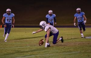 <p>Centennial Cougars close in on a dropped punt by Clarksville during Week 7 action Oct. 2, 2015. The Cougars won 42-5.</p>