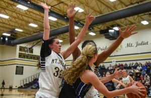 <p>Brentwood's Jenny Roy tries to pass out of a trap during the Lady Bruins 45-28 loss at Mt. Juliet in a Class AAA sectional contest Monday, March 2, 2015. The Lady Golden Bears' defense buttoned up the Brentwood offense all night. Roy led her team with nine points.</p>