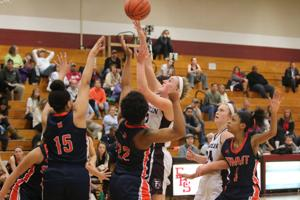<p>Holly Harris of Franklin goes up for two of her game high 22 points in a 38-37 home loss to Summit Monday night. Olivia Colson (15) and Zee Esmon (22) try to prevent the bucket.</p>
