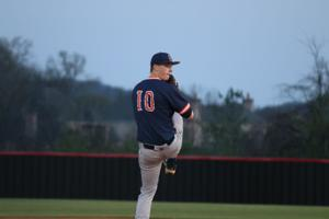 <p>Summit's Zach Mather prepares to deliver the pitch in the Spartans' gut wrenching 4-3 loss at Ravenwood Tuesday.</p>