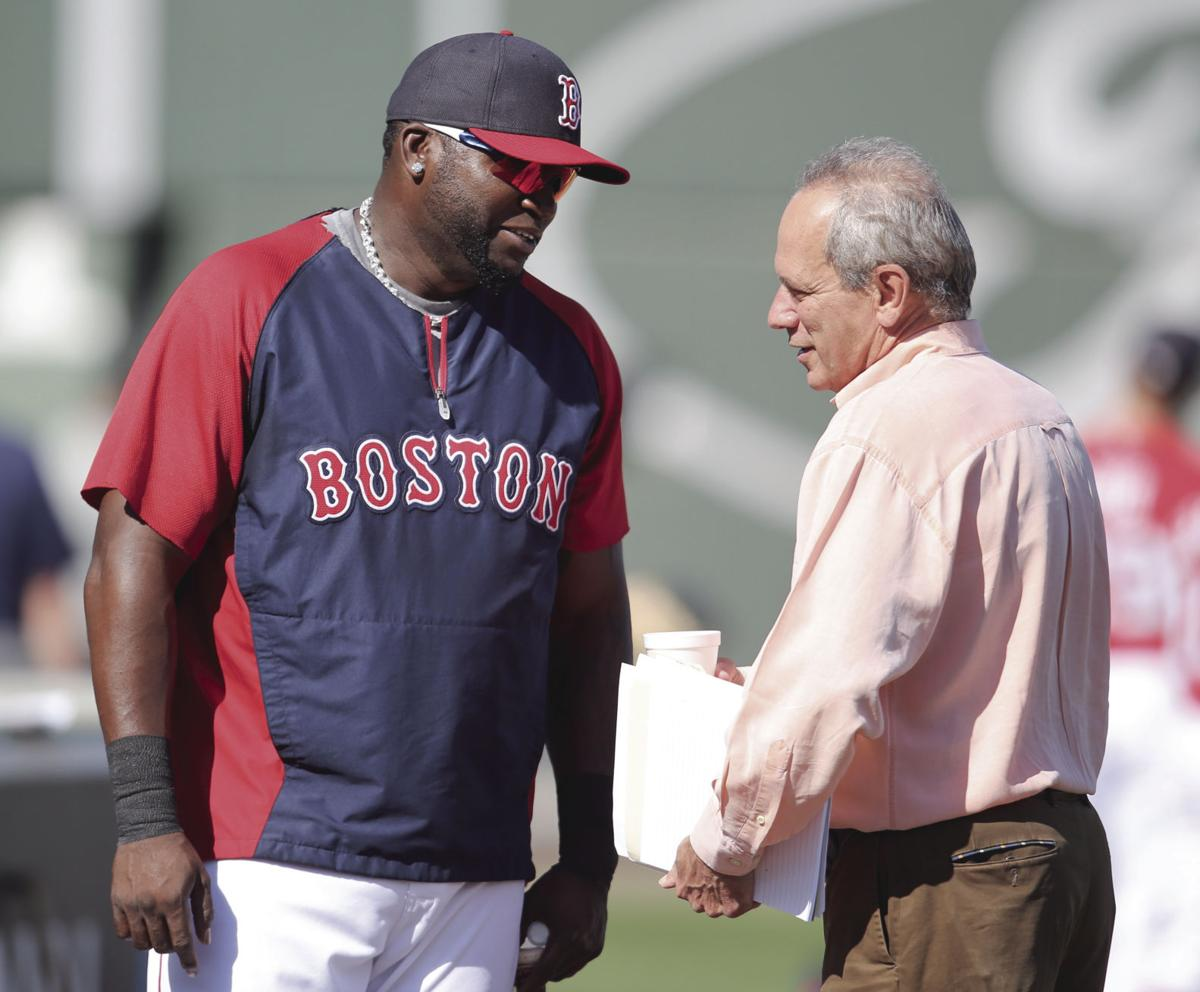 Boston Red Sox designated hitter David Ortiz, left, talks with Red Sox president and CEO Larry Lucchino before batting practice in Fort Myers, Fla. on Thursday, March 20, 2014.