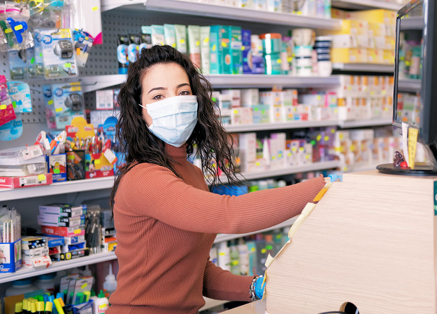 Cashier  with COVID mask