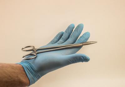 Surgeon glove stock image