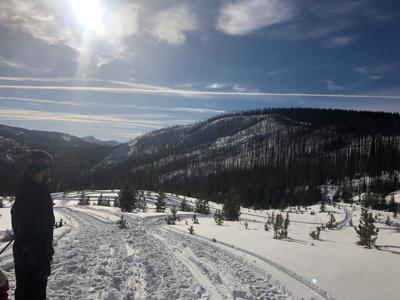 Man pinned under snowmobile, rescued near Lolo Pass