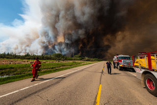 Canada fire update: Lolo Hotshots keeping the fire at bay