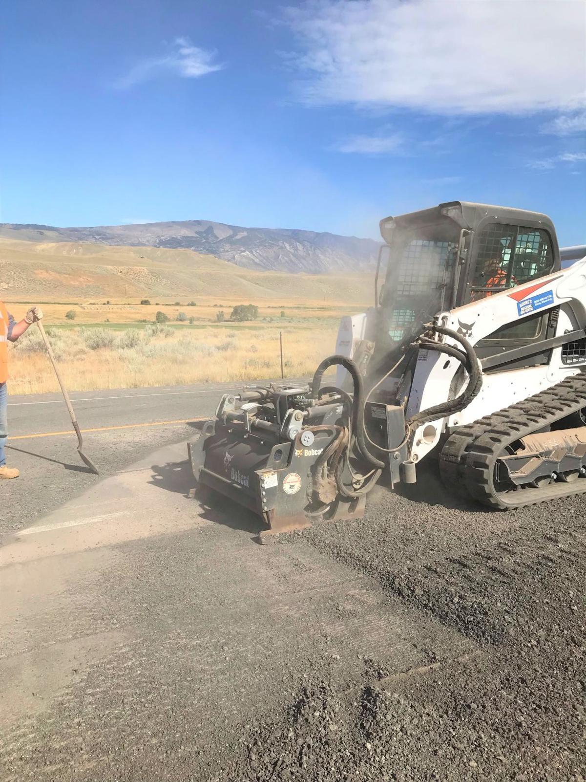 Maintenance crews repairing roadway bumps north of Cody