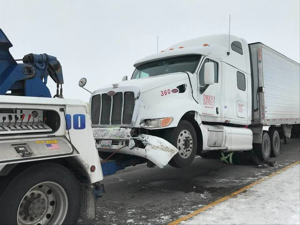 Semi hits police vehicle on I-90 near Bozeman
