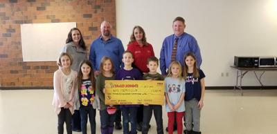 Taco John's presents check to Boys and Girls Clubs of Yellowstone Co.