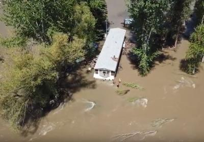 Fire sparks as crews try to secure flooded Missoula mobile home