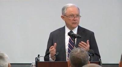 Attorney General Sessions speaks in Bozeman while protesters demonstrate outside