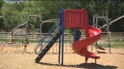 Warning: Hot playground equipment can burn kids