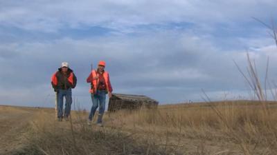 Hunters walking