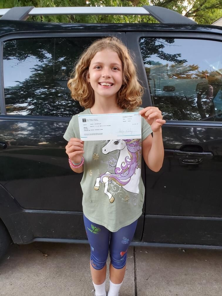 Tessa with her donation check