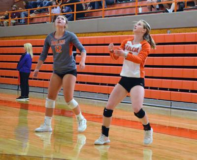 Cowgirl volleyball splits dual with Lady Tigers