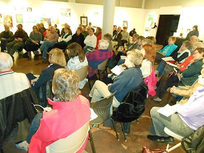 Alton arts center supporters take plight to community