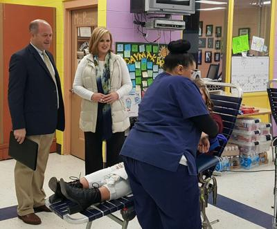 Dr. Philip Cleveland tours Marshall Technical School