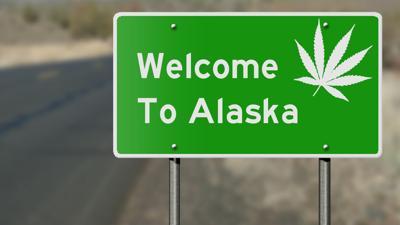 Welcome to Alaska highway sign with marijuana leaf