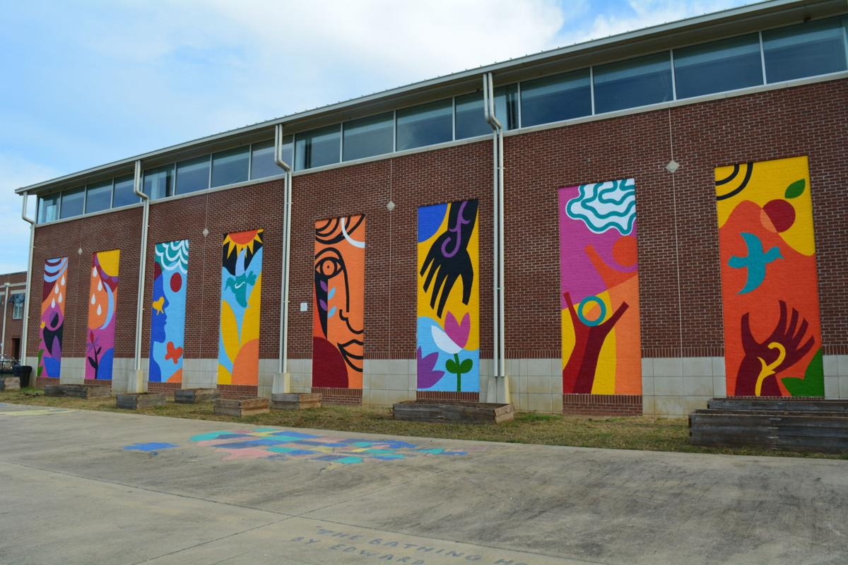 Mural unveiled at Lincoln Elementary Magnet School