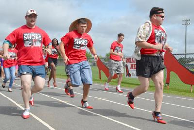 Men preparing to 'Walk a Mile in Her Shoes'