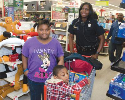 Shop With a Cop brings Christmas smiles   News   albanyherald com
