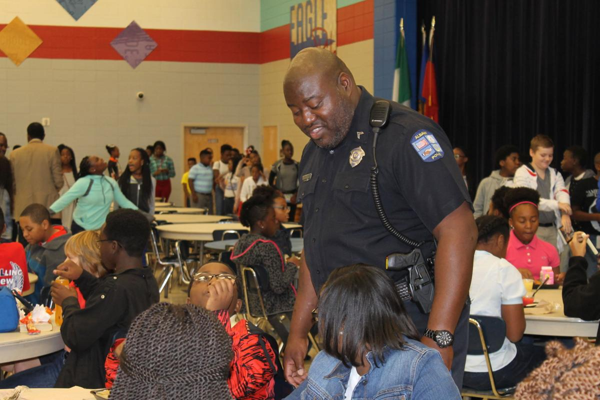 Albany police officers serve lunch at Robert Cross Middle School ...