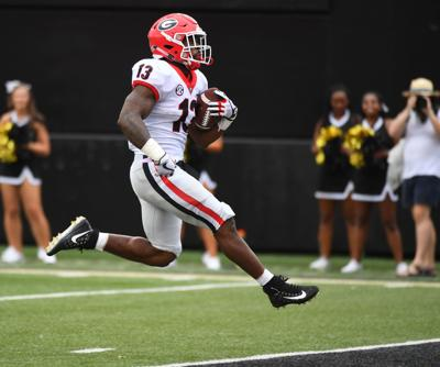 c91682e661c Famously named running back ready to roll for junior season at Georgia. Elijah  Holyfield ...