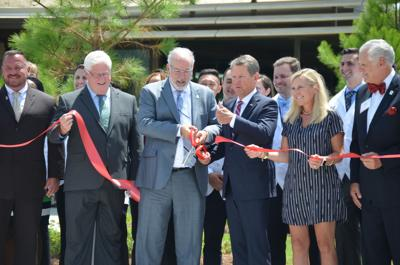 Gov. Brian Kemp helps to cut ribbon on PCOM South Georgia in Moultrie