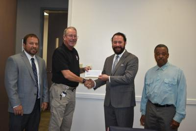 GEMA presents disaster recovery check to Dougherty County