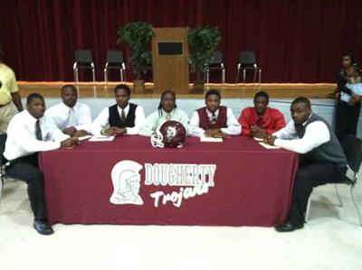 Trojans send seven football players to college