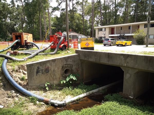 600x450 Pipe under bridge by apartments, Vacuuming the creek, in Valdosta sewer spill into Onemile Branch, Drexel Park, by Scotti Jay, for WWALS.net, 3 August 2019
