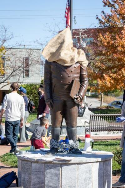 Group for statue removal holds first protest