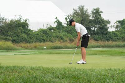 Golf swings into first place at home invitational