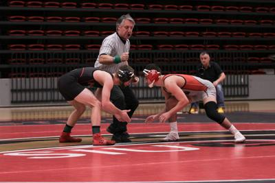 Wrestling earns first conference win at home meet
