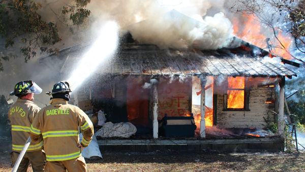 Fire departments join forces in practice burn