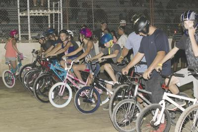 Kids line up for the bike race Saturday night at Orland Raceway.