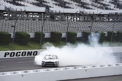 Pocono's historic, long day of racing capped by a Denny Hamlin win