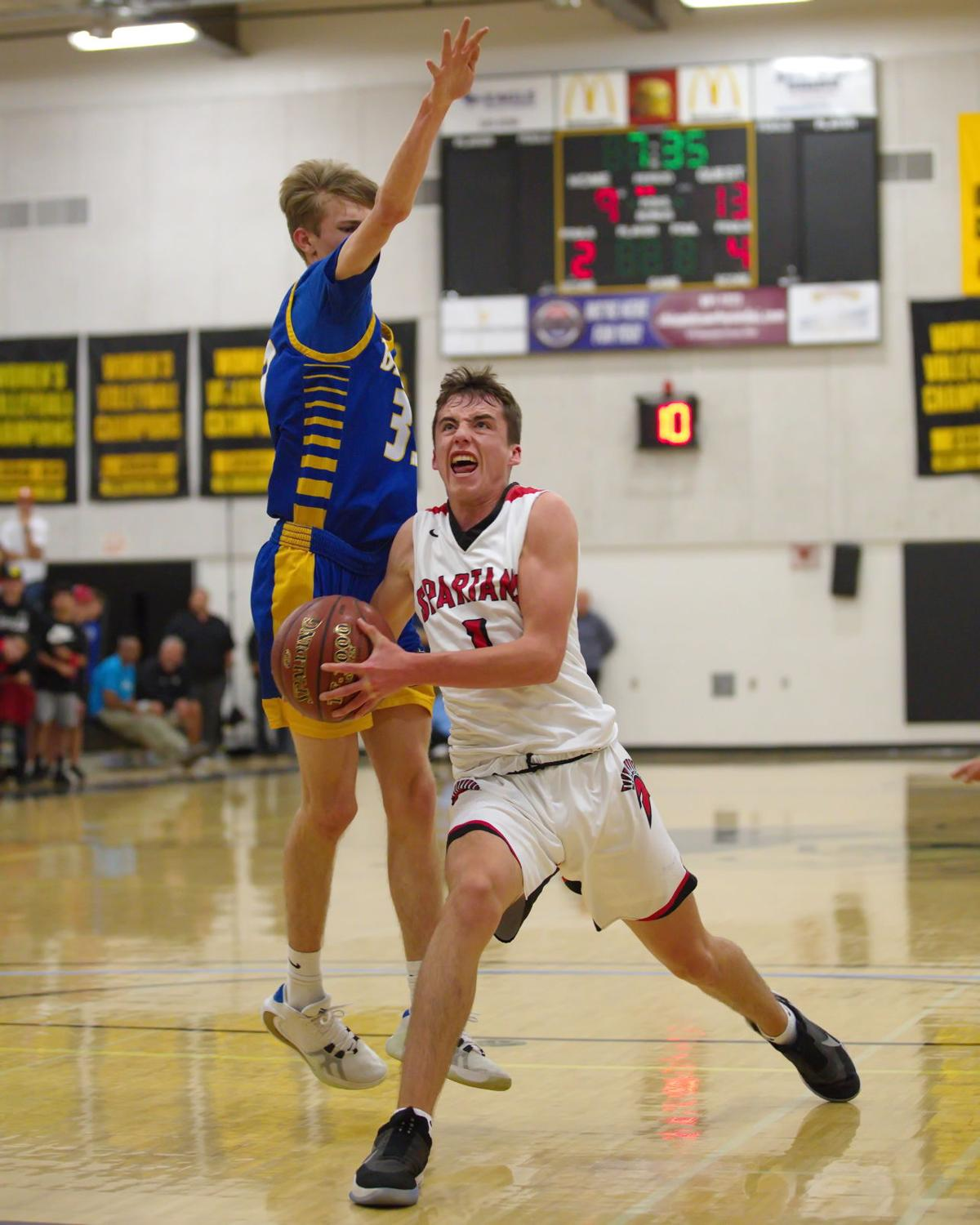 Kent Earhart (1) of East Nicolaus drives past the defense of Mt. Shasta's Avery May (33) in the D5 title game played in Butte Valley Friday night (Photo by Eddie Saltzman)