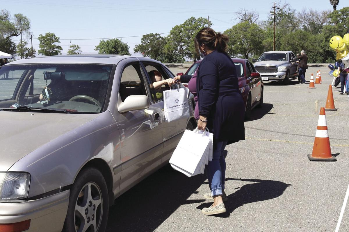 Drive-thru family fair offers community resources