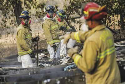 A Search And Rescue Team Combs Through Debris For Human Remains After The Camp Fire Destroyed Most Of Paradise On Tuesday November 20 2018