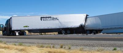 Big rig crash demolishes semi's cab