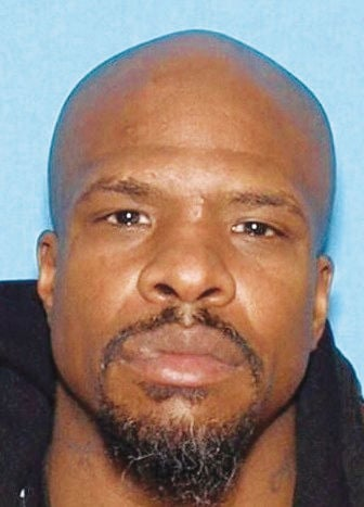 Attempted murder suspect at large, one behind bars