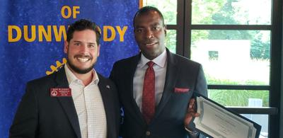 Rep. Mike Wilensky stands with Ardy Bastien, president of Dunwoody Rotary Club.