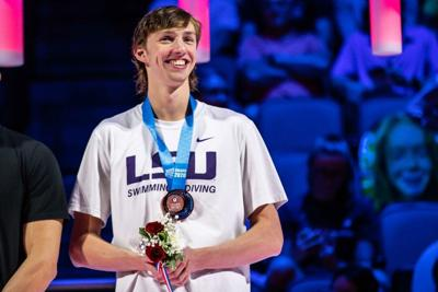 Brooks Curry celebrates after qualifying for U.S. Olympic swim team