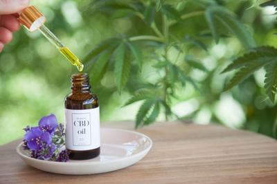 CBD Cannabis Oil (cannabidiol) from bottle on small plate
