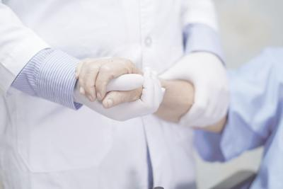 stock photo Doctor holding touching hands