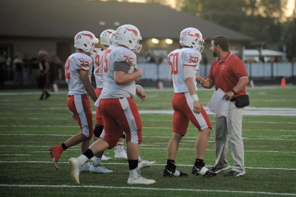 Plymouth players meet with coach.jpg