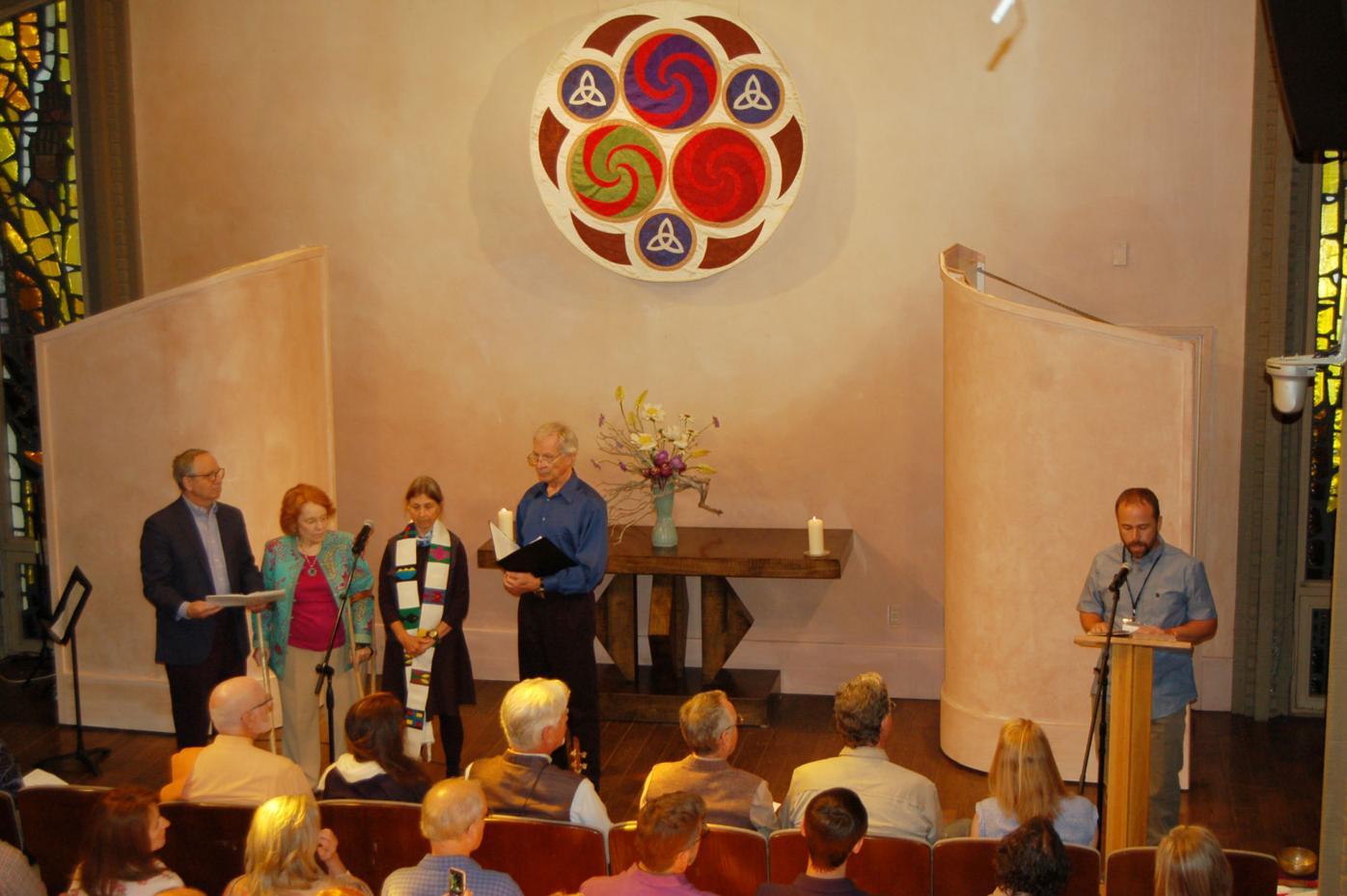 Erik Keeney (right) addresses the Aspen Chapel gathering.JPG